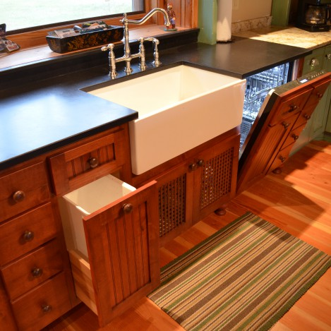 paneled garbage pullout and hidden dishwasher panel
