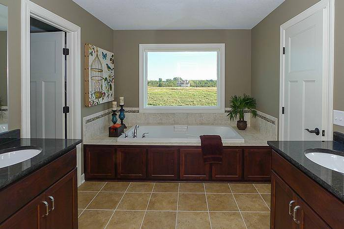 Paneled Jacuzzi tub and stained vanities