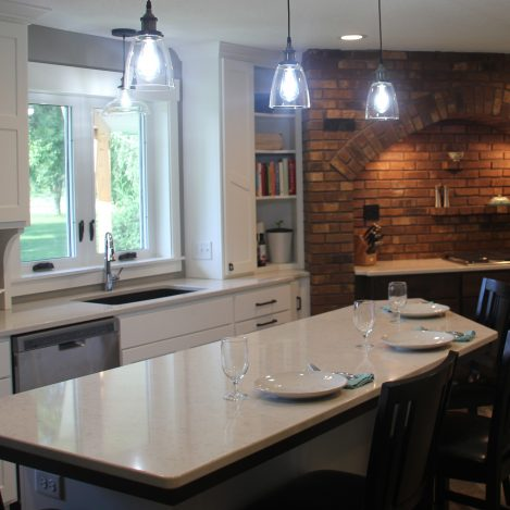 Modern Shaker White Kitchen with brick accent