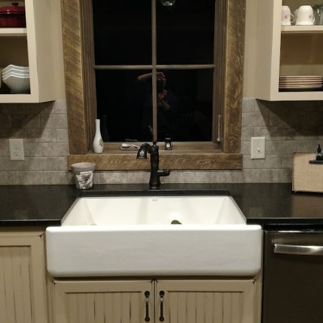 Rub through Paint with antiquing and Rustic Alder bead board cabinets and farmhouse sink.