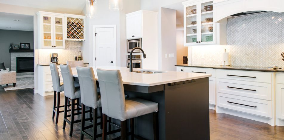 White Painted, shaker style Kitchen and Stained Island