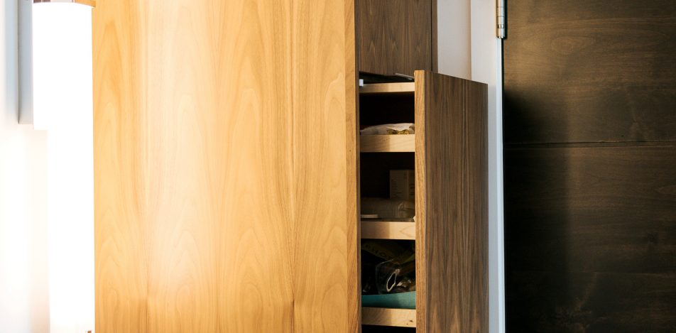 Tall frameless walnut bathroom storage