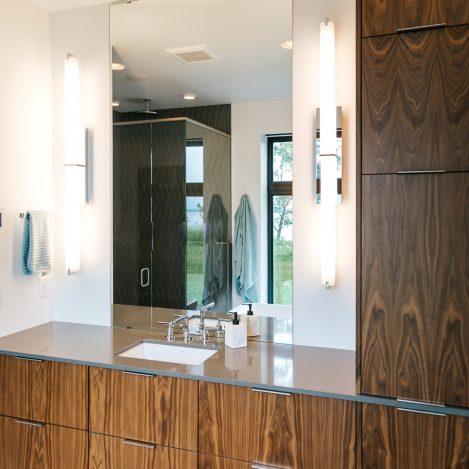 frameless vertical grain walnut vanity with undermount sink and quartz top