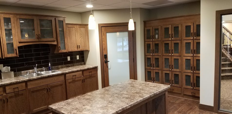 Country Manor Oak Cabinets with forest glass