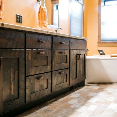 Rustic Hickory Skip Sawn Vanity stained Rustic Black with granite countertop
