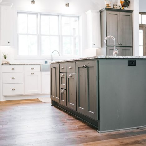 Kitchen Island and tall wall cabinet painted Grizzle Grey with white cabinets