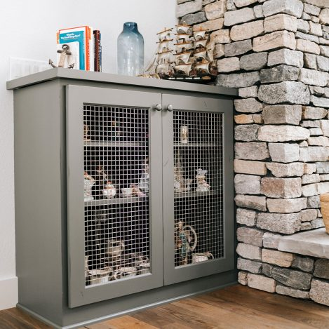 Fireplace side cabinet with wire mesh panel insert painted grizzle grey