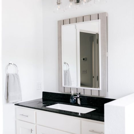 White vanity with square bowl and cultured marble top