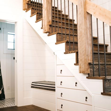 Built-in full overlay dresser under stairs painted Navajo White