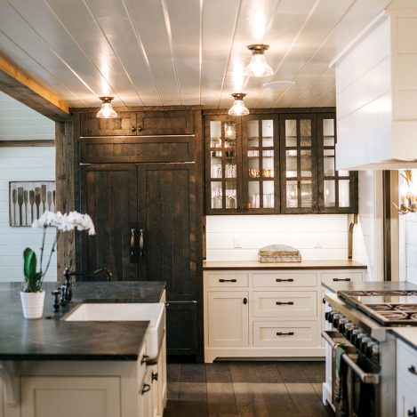 Rustic Oak Skip Sawn paneled refrigerator and 6 lite glass doors with Navajo White bases