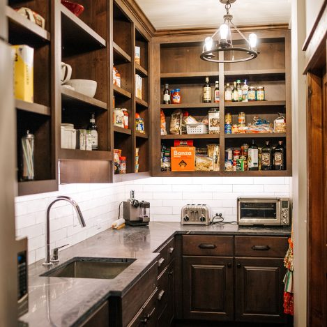 Rustic Alder pantry with open finished cabinet uppers, extra refrigerator and sink