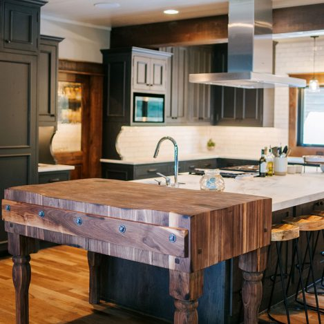 Rustic oak skip sawn island with butcher block, floating shelves and rustic Alder painted inset cabinet perimeter