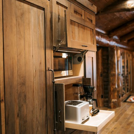 Appliance Cabinet, full overlay rustic hickory with pocket doors and Aventos lift door