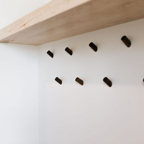 Minimalist coat pegs with wood shelf