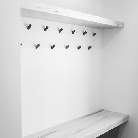 Minimalist coat pegs with wood shelf and bench